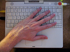 Hand on keyboard by Branko Collin