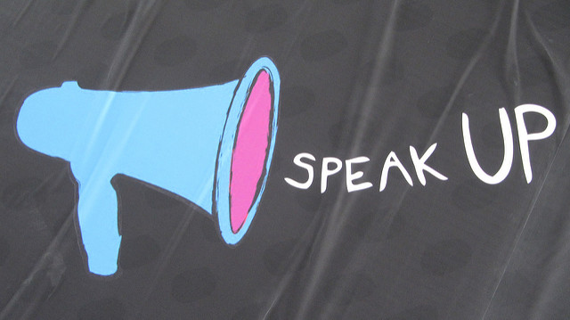 "Megaphone with words ""speak up"""