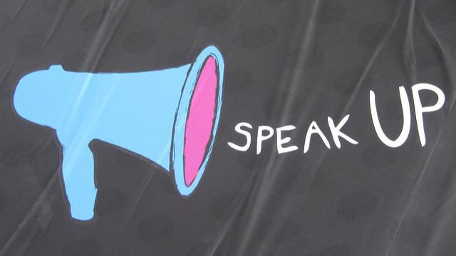 "Megaphone with words ""speak up"""